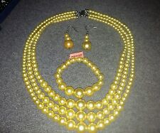 Simulated Yellow Pearl Set of Earrings, Bracelet and Necklace in Stainless Steel