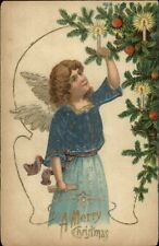Christmas Angel Lighting Candle on Tree c1910 Postcard rpx