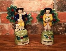 Pair of Staffordshire Shepherd & Shepherdess with Bocage Foliage Figurines