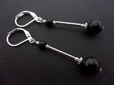 A PAIR OF DANGLY BLACK ONYX  BEAD  SILVER PLATED LEVERBACK HOOK EARRINGS.
