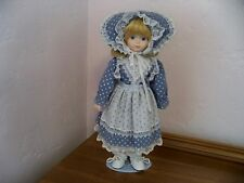 BEAUTIFUL BLOND AND BLUE EYED CHINA AND CLOTH DOLL JRL TOYS