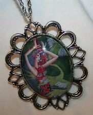 Handsome Festooned Silvertone Green and Red Polynesian Lady Pendant Necklace