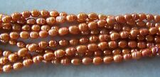 """16"""" Strand Deep Tangerine Freshwater Pearl Small Rice Beads 5mm-6mm"""