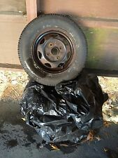 "Four 13"" winter tires and rims -- lightly used and in great condition"