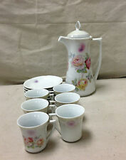 VINTAGE 7 PIECE GERMAN CHOCOLATE POT AND 6 CUP/ SAUCER SET