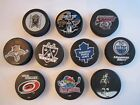 10 NHL HOCKEY PUCKS - VARIOUS TEAMS - 1999 STANLEY CUP, MAPLE LEAFS & MORE BN-4