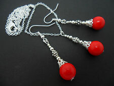 A RED CORAL BEAD NECKLACE AND EARRINGS SET. NEW.