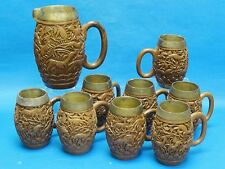 VINTAGE 60s INTRICATE CARVED WOOD PITCHER & 8 MUGS WITH METAL INSERTS
