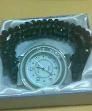 "BLACK TRIPLE STRAND LARGE FACE WATCH WITH MOVIMG CRYSTALS IN FACE FITS 7"" TO 10"""