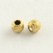 20 pcs Tiny 4mm ROUND GOLDEN BRASS stardust perline grandi fori risultati