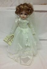 Seymour Mann's Musical Doll Reproductions Wind Up Porcelain Doll in White Dress