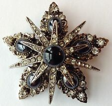 VINTAGE ART SIGNED BLACK AND CLEAR RHINESTONE STAR BROOCH