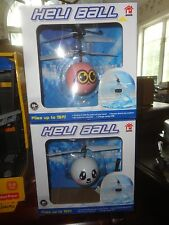 TWO DIFFERENT HELI BALLS, WHITE AND PINK FACED, BOTH  SEALED