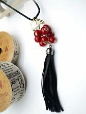 Black chain with a white crystal and red crystal baubles necklace