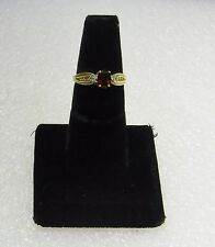 10K Yellow Gold Ring W/Oval Garnet Center & (10) Rd Cut Dia Accents Size 7 G9-I