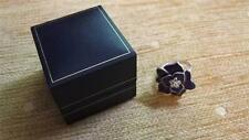 Boxed Hallmarked silver ring mauve flower with stones,size o,us 7.5,weight 10g