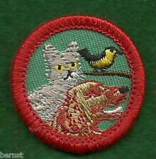 GIRL SCOUT WORLDS TO EXPLORE BADGE - RED - PETS. - FREE SHIPPING