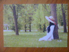 POSTCARD..SEXY GIRL IN THE WOODS...LONG BLACK HAIR..WHITE DRESS..STRAW HAT