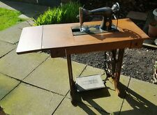 Antique vintage Singer Sewing machine base table cast iron and wood,