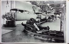 """1957 Chevrolet assembly line Body in the air 12X18"""" Black & White Picture"""