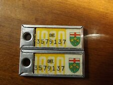 Pair of 1980 License Plate Key Tags. Ontario Canada. War Amps Key Return Service