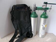 Portable oxygen tank w carrying case and Regulator, With extra tank.