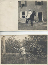 SET OF TWO POSTCARD PHOTOGRAPHS OF BABY IN GRASS   WOMAN ON HORSE