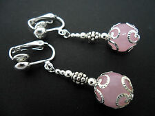 A PAIR OF DANGLY PINK JADE BEAD  SILVER PLATED DROP CLIP ON EARRINGS.