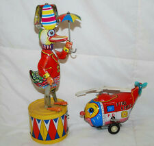 VINTAGE LOT OF 2 TIN LITHO WIND UP TOYS DUCK W UMBRELLA & FIRE CHIEF HELICOPTER