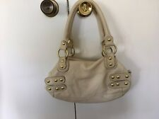 Linea Pelle cream color leather purse with gold studs