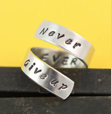 Never Ever Give Up Adjustable Twist Wrap Ring - Aluminum