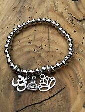 silver ball stretch bracelet with spiritual charms stacking Ohm Buddha Lotus