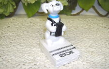 MCDONALD PREMIUM TOY 101 DALMATIONS W/ ACCORDIAN ON SHEET MUSIC