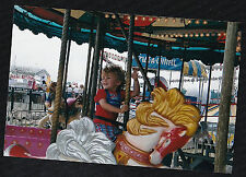 Cool Photograph Adorable Little Boy Riding on Carousel Horse At Carnival