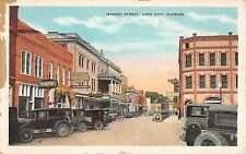c.1920 Stores Drug Store Early Cars Marion St. Lake City FL post card