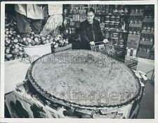 1960 Kansas City MO Woman Views Huge Apple Pie In Grocery Store Press Photo