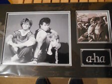 a-HA personally band signed CD cover - Mounted and matted