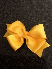 HANDMADE-GIRLS DOUBLE BOWS . YELLOW GOLD COLOUR HAIR CLIP