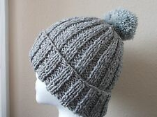 Hand knitted elegant and warm pompom beanie/hat, wool, light silvery gray