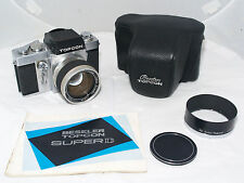 Beseler Topcon Super D pro 35mm film camera with 58mm f/1.4 lens, hood, case.