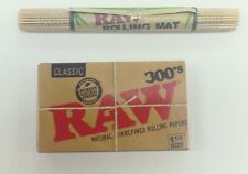 RAW 300'S CIGARETTE ROLLING PAPERS 1.25 SIZE NATURAL UNREFINED W/ RAW BAMBOO MAT