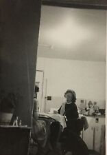 Vintage Photograph Candid image of woman in kitchen 1950s