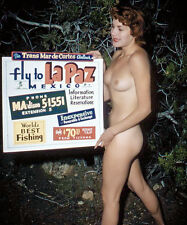 1960s Nude red head pinup Holding up a Mexican Airline poster 8 x 10 Photograph