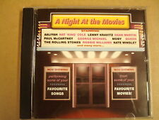 CD / A NIGHT AT THE MOVIES ( LENNY KRAVITZ, THE ROLLING STONES... )