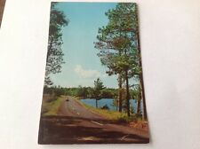 Postcard 1957 Scenic Drive in Minnesota. Vacationland. Blue sky, water, old car.