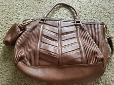 Brown lined textured purse handbag with adjustable strap, plus coin purse