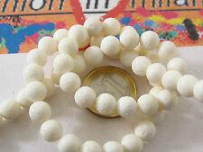 1 filo di corallo madrepora bianco circa 52 perle di 8 mm