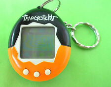 97' BANDAI TAMAGOTCHI VIRTUAL PET GAME BLACK ORANGE *WORKS* KEYCHAIN CYBER TOY