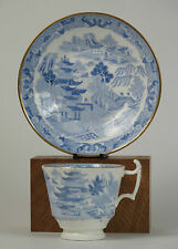 Spode china 'Broseley Chinoiserie' coffee cup and saucer. (Gilded rims) c1820