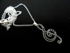 "A LOVELY TIBETAN SILVER TREBLE CLEF MUSICAL NOTE  NECKLACE ON 18"" CHAIN. NEW."